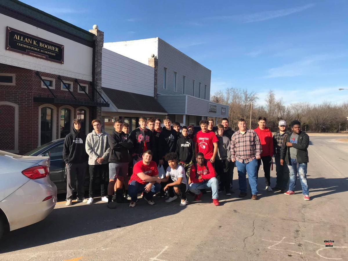 LHS football team helped with the move to the new Town Hall.